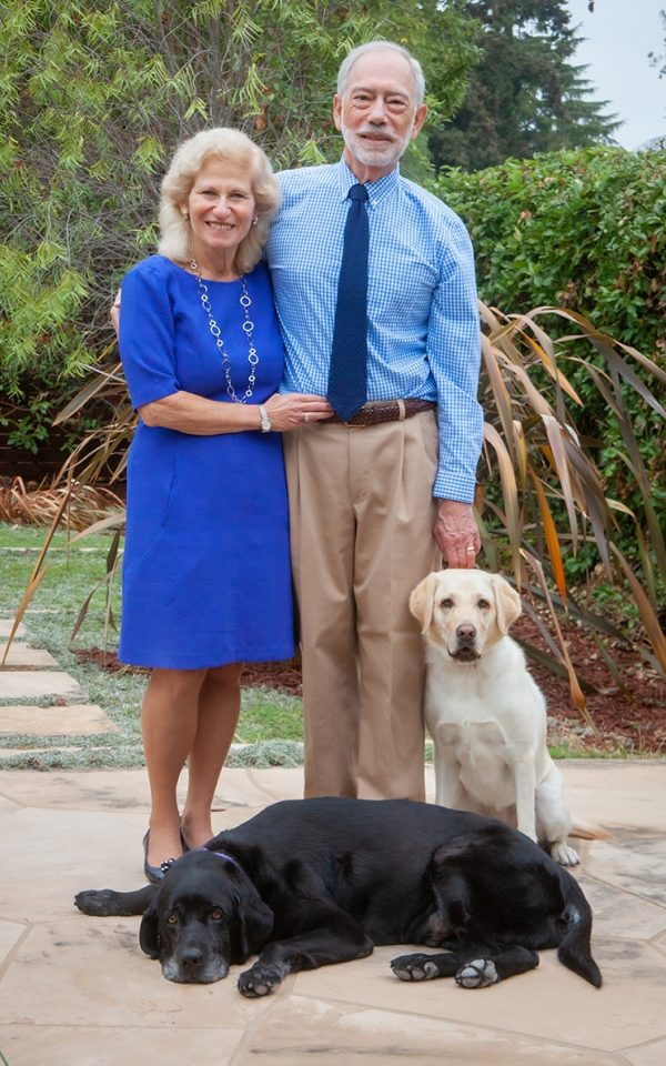 Donors Erika and John Ammirati pose in their yard with their carreer change dogs Fondy and Shiloh.