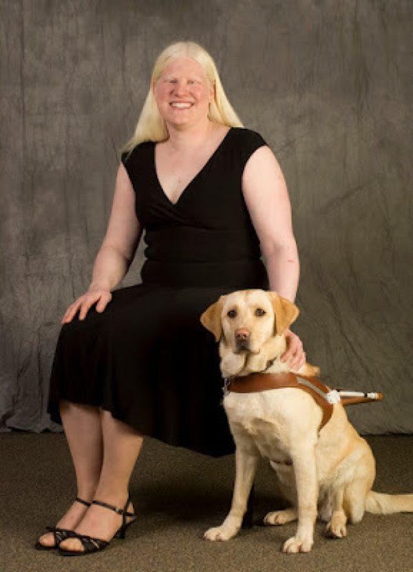 GDB graduate Nicole Schultz-Kass with her guide dog.