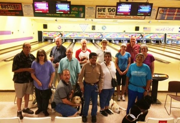 Members of the Rocky Rovers GDB alumni chapter pose with their guides at the bowling alley.