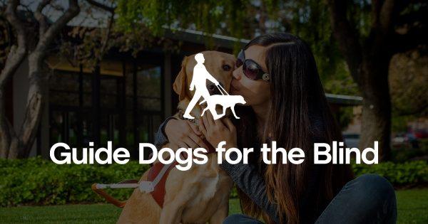 Puppy raiser Megan Iriving with a black Lab puppy